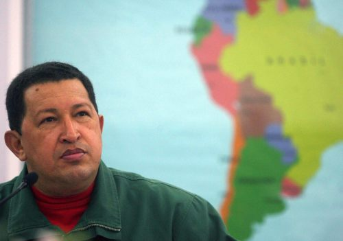 Venezuelan President Hugo Chavez listens during a ceremony at the Mir